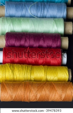 row of bobbins - stock photo