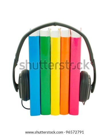 Row of books and headphones isolated over white - stock photo