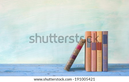row of books, grungy background free copy space - stock photo