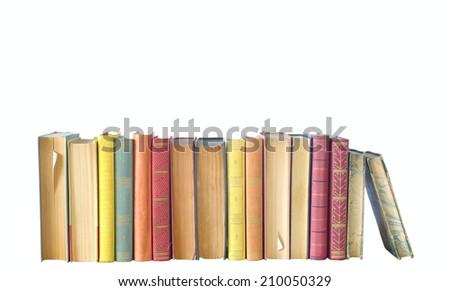 row of books, isolated on white background - stock photo