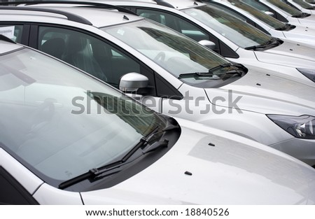 row of brand new cars on parking - stock photo