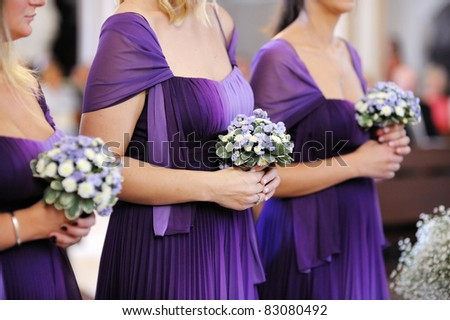 Row of bridesmaids with bouquets - stock photo