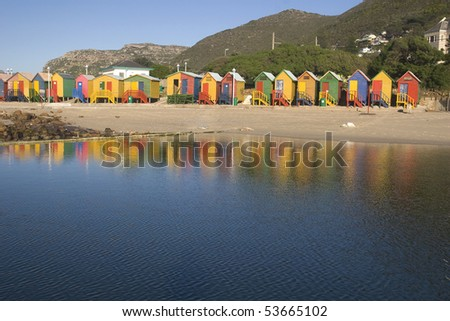 Row of brightly colored beach huts at St James. Cape Town, South Africa - stock photo