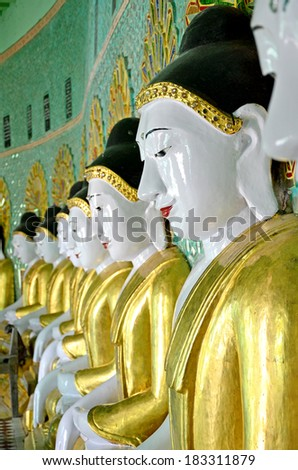 Row of Buddha Statue in Burmese Style in The Soon U Ponya Shin Monastery on Sagaiing Hill, Sagaiing City, The Old City of Religion and Culture Outside Mandalay, Myanmar. - stock photo