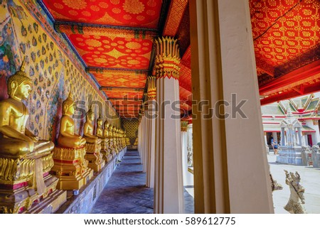 Row of Buddha statue in long corridor at Wat Arun temple which is a public place, Bangkok Thailand.