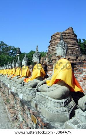 Row of Buddhas at the temple of Wat Yai Chai Mongkol in Ayutthaya near Bangkok, Thailand. - stock photo