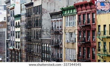 Row of buildings on a block in Chinatown, New York City - stock photo