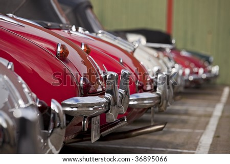row of bumpers of classical cars - stock photo