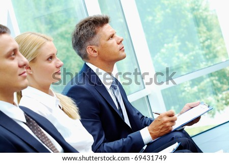 Row of business group at conference - stock photo