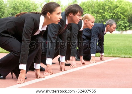 Row of business people getting ready for race - stock photo