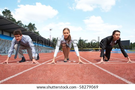Row of business people getting ready for race on stadium - stock photo