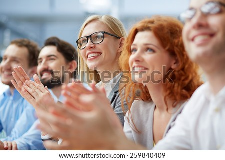 Row of business people sitting at seminar - stock photo