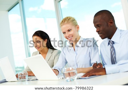 Row of business people sitting in office and planning work