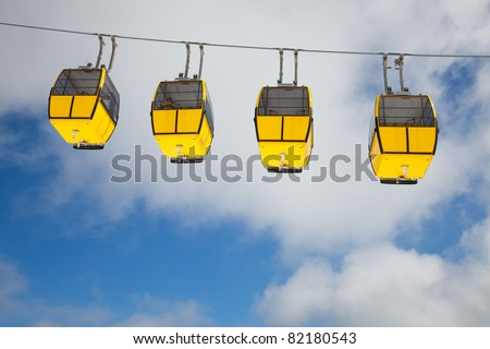 Row of cable cars in the sky - stock photo
