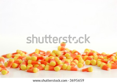 Row of candy corn against a white backdrop. - stock photo