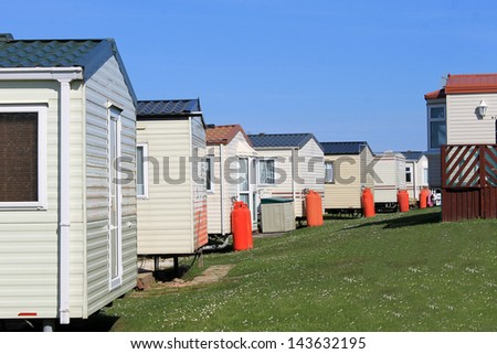 Row Of Caravans In Trailer Park Summer Scene