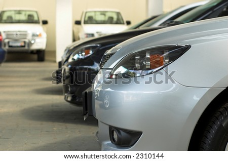Row of cars for sale in motor dealership - stock photo