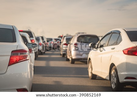 row of cars on express way, traffic jam with morning light - stock photo