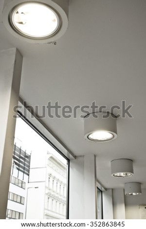 Row of ceiling lights in a modern building - stock photo
