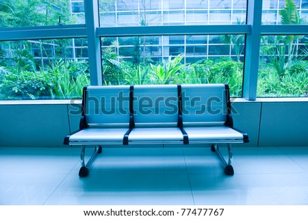 row of chair  in modern office building. - stock photo