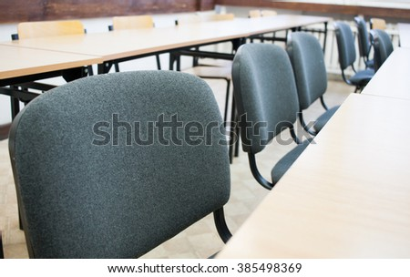 Row of chairs in classroom - stock photo