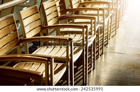 row of chairs in sunlight