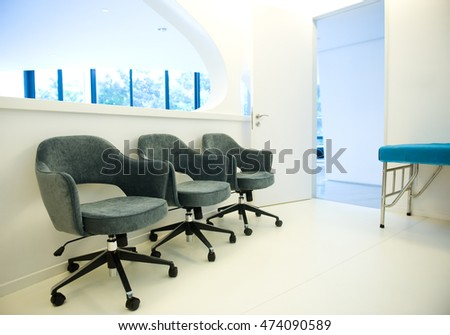 Row of chairs in waiting room.