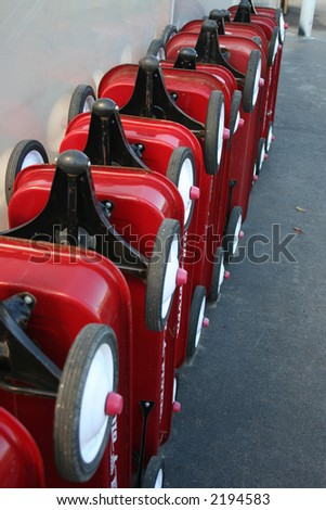 Row of children's red wagons
