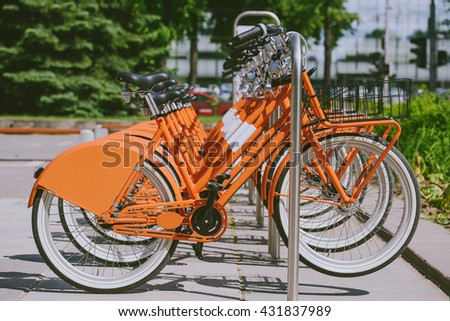 Row of city bikes for rent at docking stations in Kaunas, Lithuania - stock photo