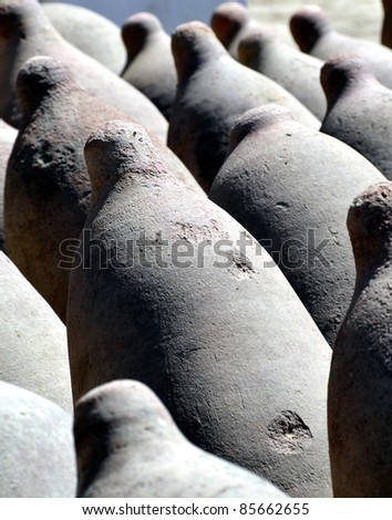 Row of Clay Wine Fermentation Storage Tanks for wine making in Ica Winery Peru - Vertical Closeup