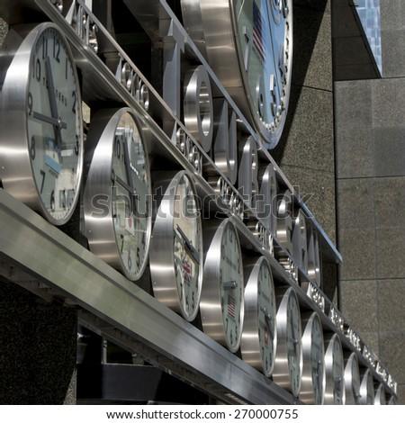 Row of Clocks on building, Manhattan, New York City, New York State, USA - stock photo