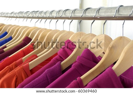 Row of clothes hanger with t-shirt - stock photo
