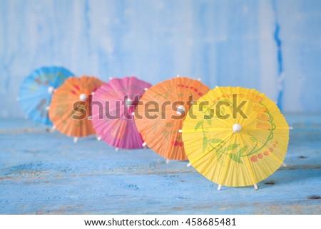 row of cocktail umbrellas, selective focus, copy space - stock photo