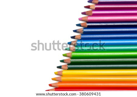 Row of colored pencils placed diagonally on white isolated. Colorful crayons used for drawing