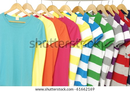Row of colored Tee Shirts display - stock photo