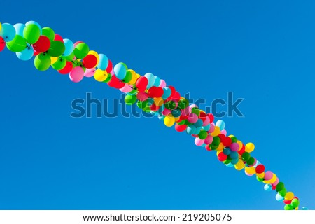 row of colorful balloons in the sky - stock photo