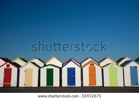 row of colorful beach hut - landscape orientation - stock photo