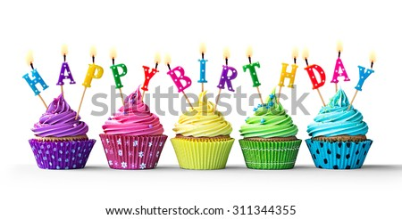 Row of colorful birthday cupcakes isolated on a white background - stock photo