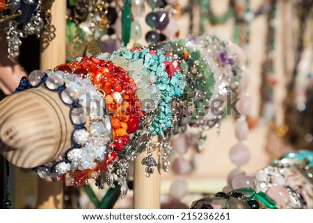 Row of colorful bracelets with shallow depth of field - stock photo