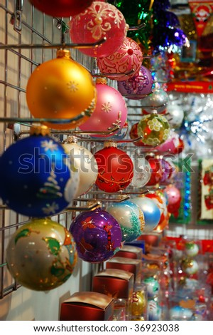 Row of colorful christmas decorations in a shop