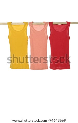 Row of colorful clothes on a wooden hanger - stock photo