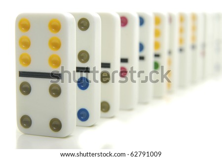 Row of colorful dominos isolated on white. - stock photo