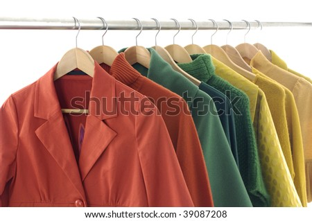 Row of colorful female coat on hangers