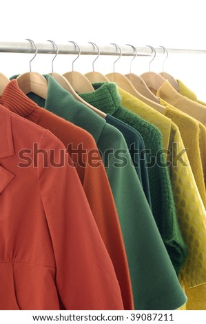 Row of colorful female coat on hangers - stock photo