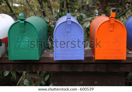 Row of colorful mailboxes.