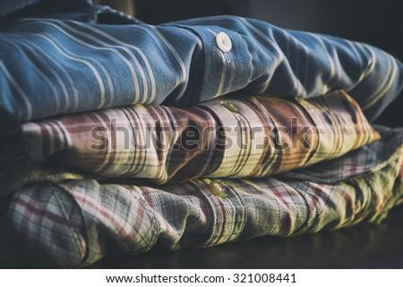 row of colorful man shirts angle view - stock photo