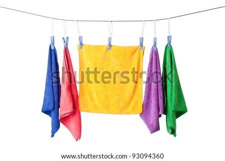Row of colorful microfiber towels hanging on a rope