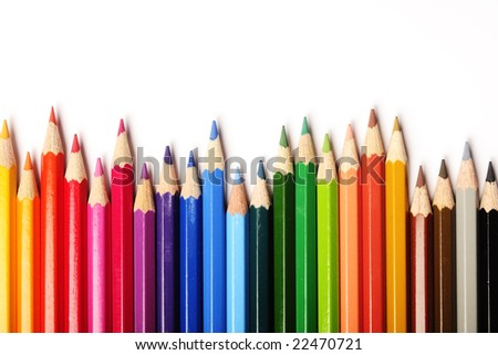 row of colorful pencils on white background - stock photo