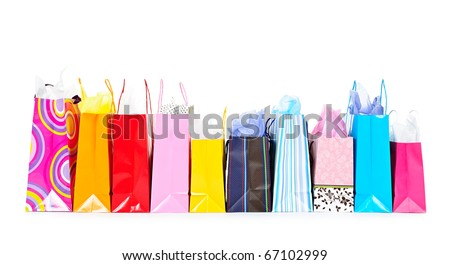 Row of colorful shopping bags isolated on white background - stock photo