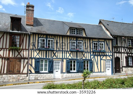 Row of colorful Timber Framed Houses in an Historic Village in Normandy, France